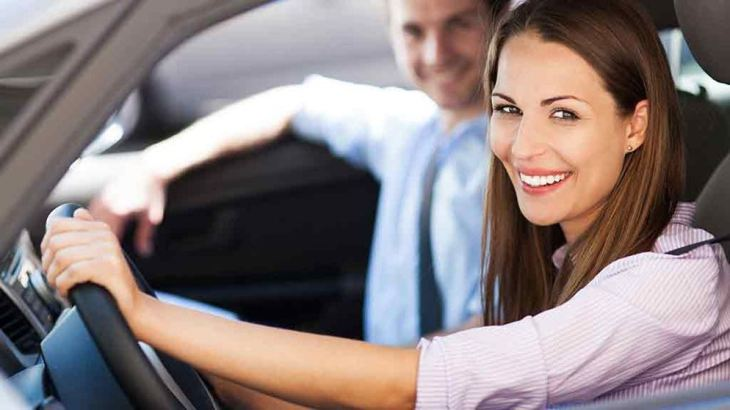 smiling-couple-drive-new-car
